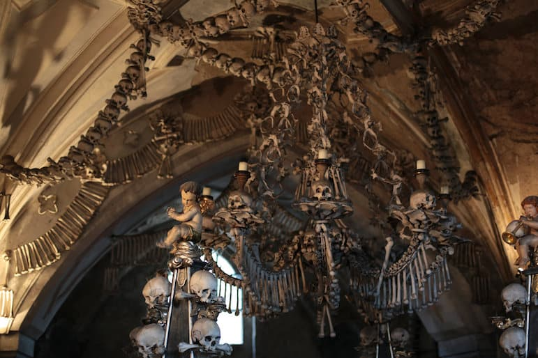 The artistic but haunting bone chandelier at the Sedlec Ossuary in Czech Republic | Pic Chris Waits