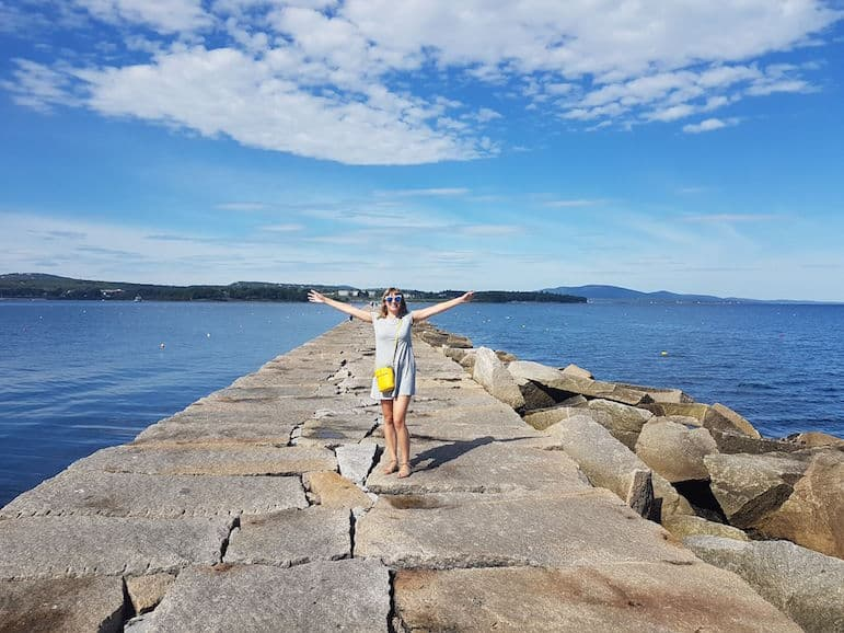 Places to go in Maine - Ella at Rockland breakwater on the Maine road trip