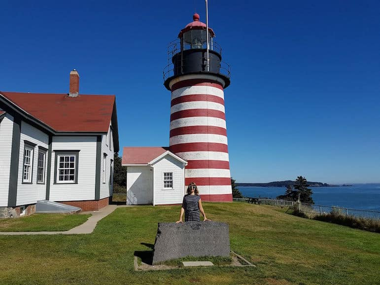 Places to go in Maine - Ella at easternmost point Quoddy Head Lighthouse on the Maine road trip