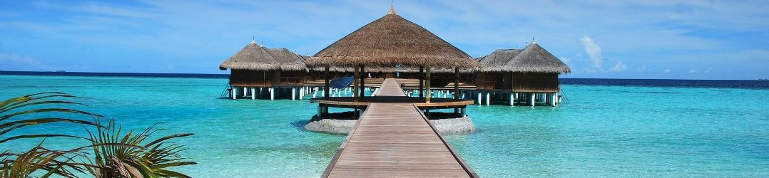 Winter sun - bungalows on stilts in The Maldives