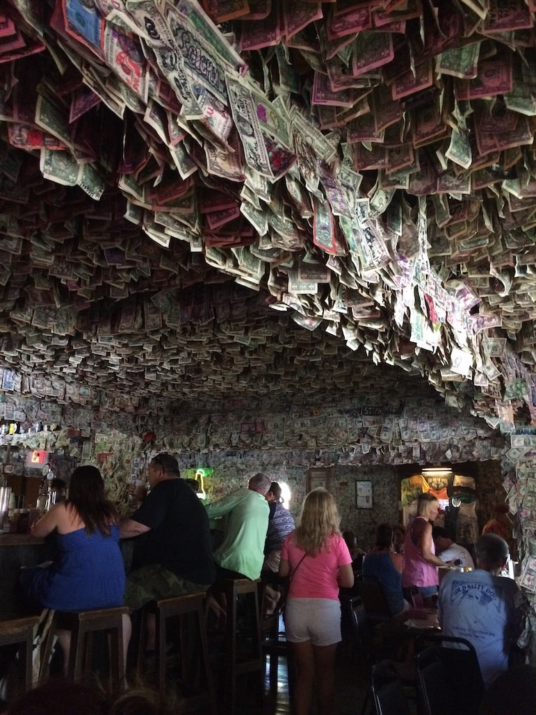 Dollar bills hang from the ceiling of the No Name Pub - one of the unusual places to visit in the Florida Keys