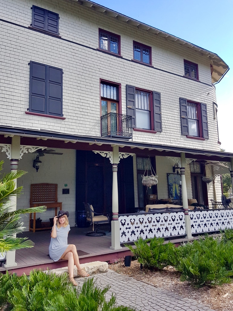 Ella gets hatted at the Stetson Mansion - one of the most historic Daytona Beach attractions