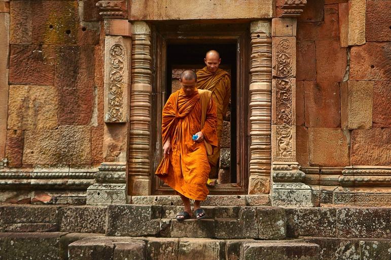 Spa treatments - tibetan monks walking in temple grounds
