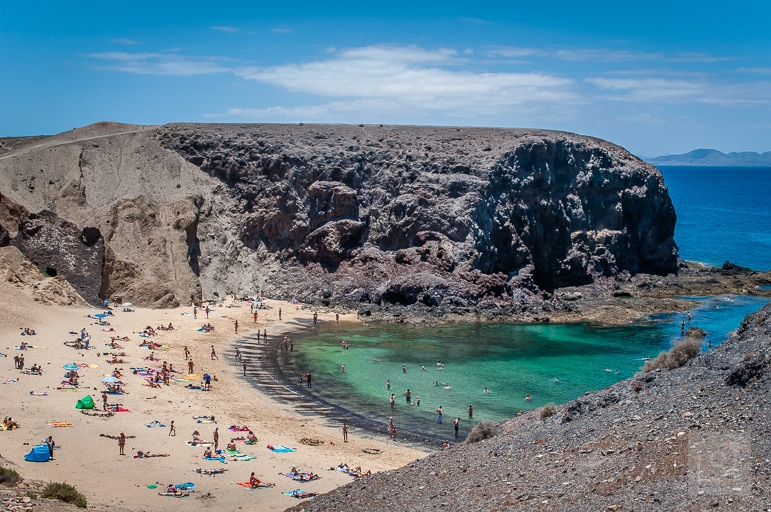 Places to go at Christmas - warm up on one of the Canary Island's beaches like Playa de Papagayo, in Lanzarote