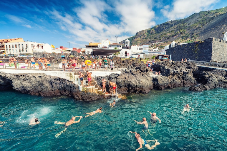 What to do in Tenerife - swimmers enjoy the volcanic rock pools Garachico is famed for