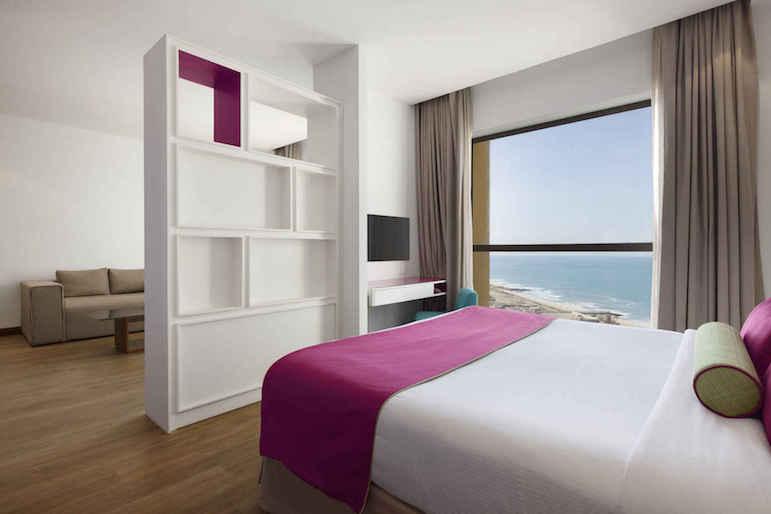 Bedroom at Hawthorn Suites by Wyndham Dubai JBR