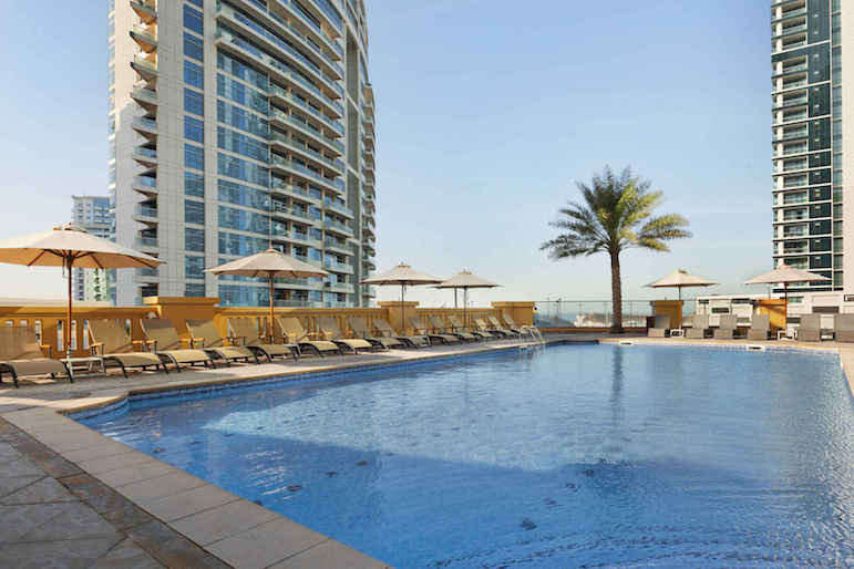Chill out pool side at Hawthorn Suites by Wyndham Dubai JBR