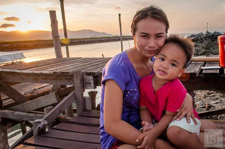 Duan and her son, First watch as the evening's dinner is caught from the Gulf of Thailand