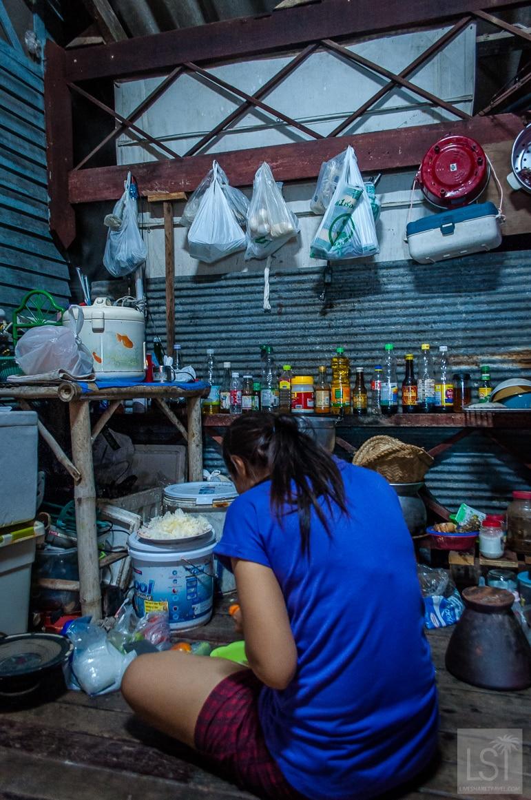 Duan preparing dinner in her open kitchen
