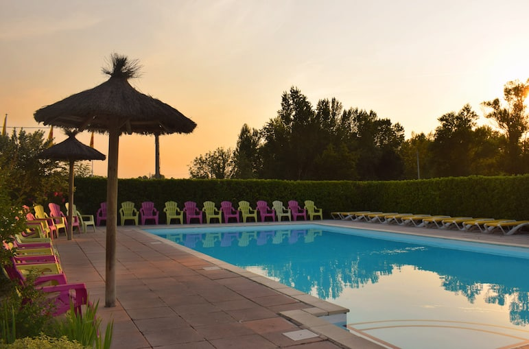 Places to stay in Bordeaux - soak up the scenery of a sunset by the pool at Yelloh! Saint-Emilion