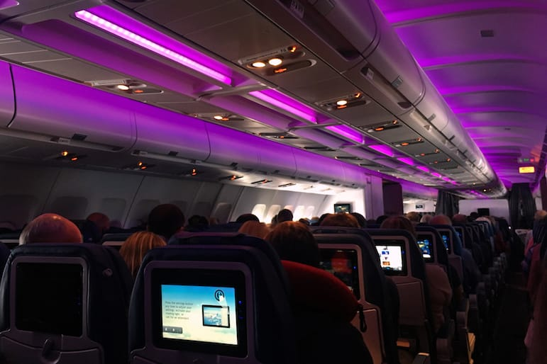 Onboard Air Transat with mood lighting in the cabin to relax and unwind for the 9 hour flight and plenty of inflight entertainment to while away the time