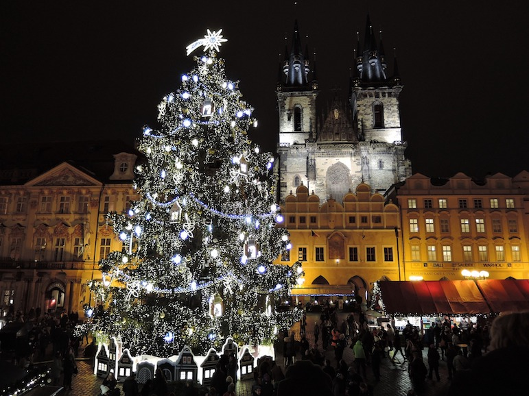 Places to go for Christmas markets - experience the bright lights of the Prague Christmas markets and the impressive backdrop of Gothic architecture of the city