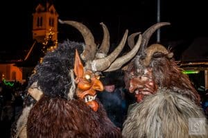 Horned Krampus demons in Igls, Austria