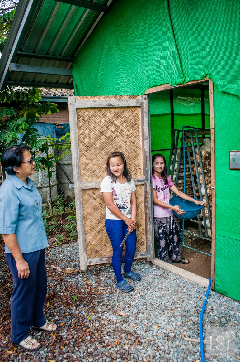 Sister Anurak and helpers show us into the mushroom farm