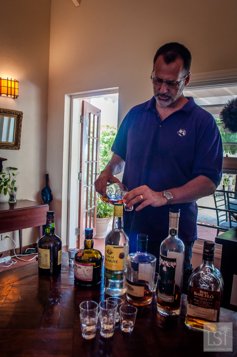 Adam pours another rum, such are holidays in Antigua