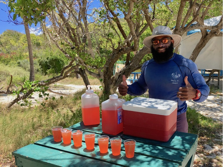 Captain Hercules serves rum punch on Bird Island