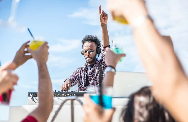DJs always get the party going at beach clubs in Tenerife
