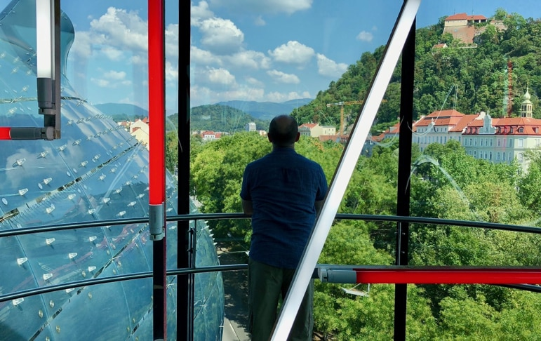 Things to do in Graz - looking out over views of the city from the Needle at the Modern Art Museum