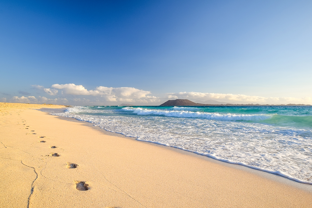 Playa Grande Beach is one of the finest on Lanzarote, with calm, shallow waters and lifeguards on duty