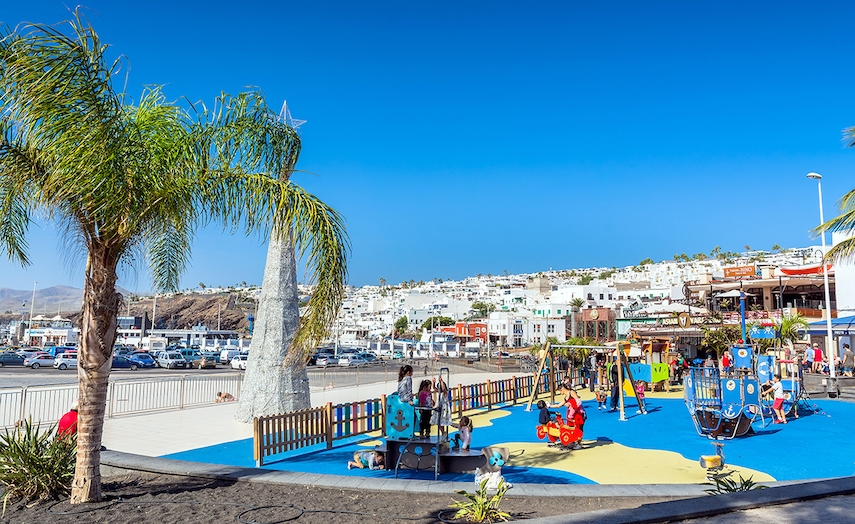 Puerto del Carmen's pretty harbour features bars, restaurants and children's playparks to keep the whole family entertained