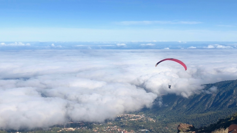 Paraglider descending into cloud at Teide National Park, Tenerife