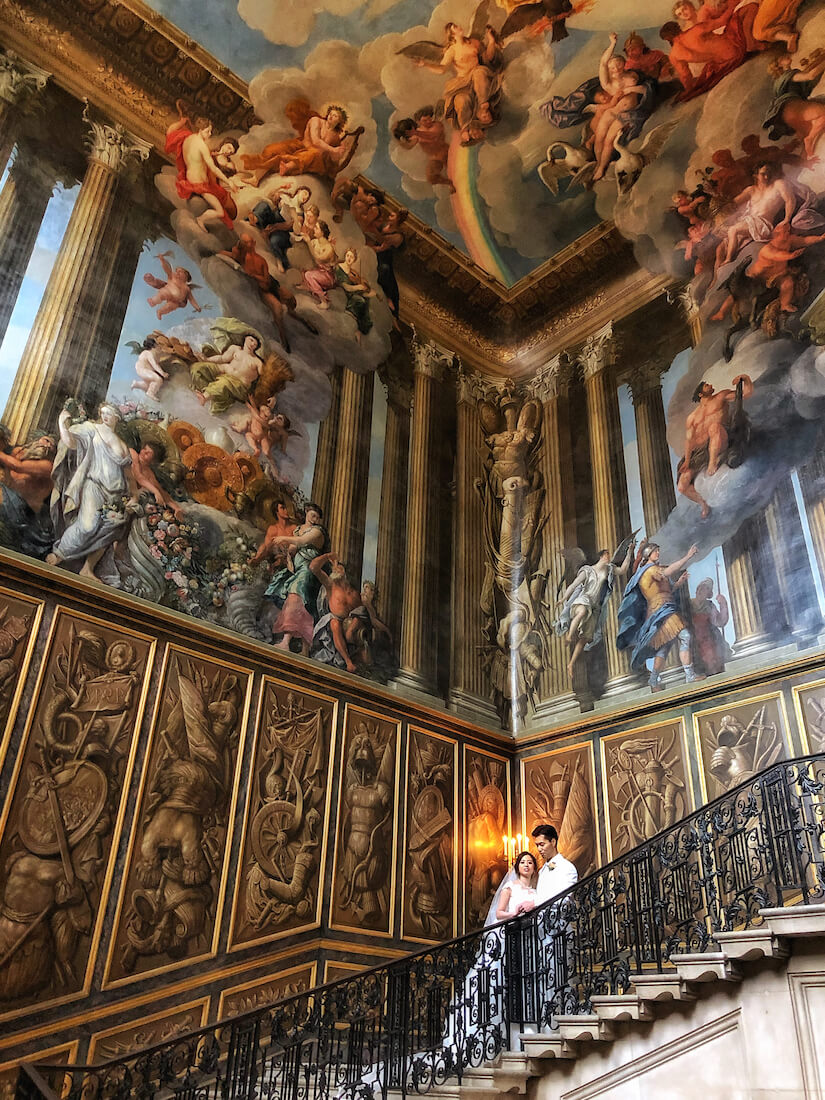 Hampton Court's grand staircase with mural by Verrio